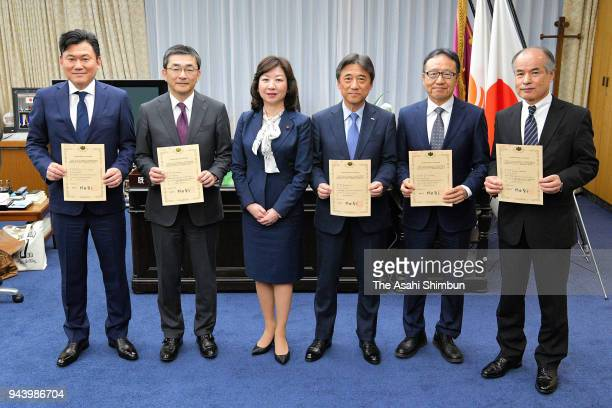 Rakuten Inc Chairman and CEO Hiroshi Mikitani receives an approval certificate to offer mobile services from Minister of Internal Affairs and...