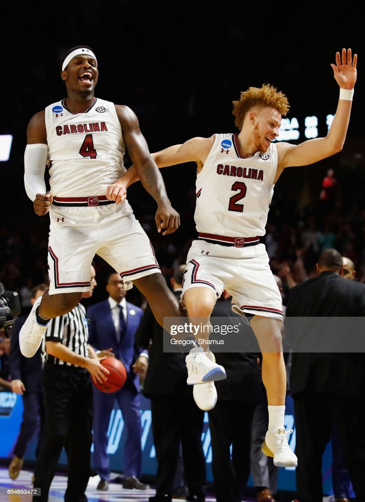 Rakym Felder #4 and Hassani Gravett #2 of the South Carolina Gamecocks celebrate their 93-73 win over the Marquette Golden Eagles during the first round of the 2017 NCAA Men's Basketball Tournament at Bon Secours Wellness Arena on March 17, 2017 in Greenville, South Carolina.