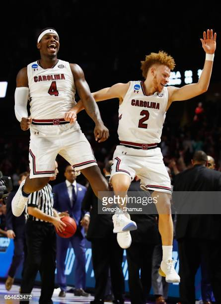 Rakym Felder and Hassani Gravett of the South Carolina Gamecocks celebrate their 9373 win over the Marquette Golden Eagles during the first round of...