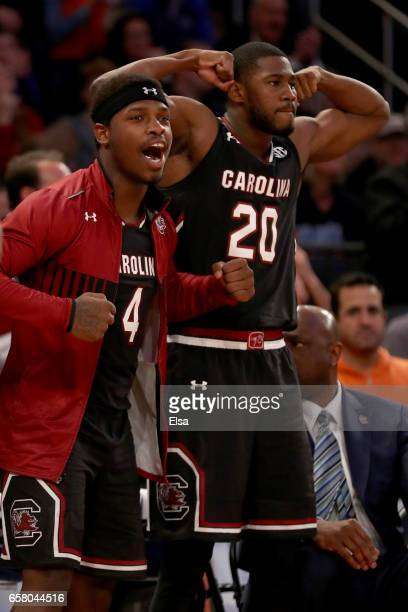 Rakym Felder and Justin McKie of the South Carolina Gamecocks celebrate from the bench in the second half against the Florida Gators during the 2017...