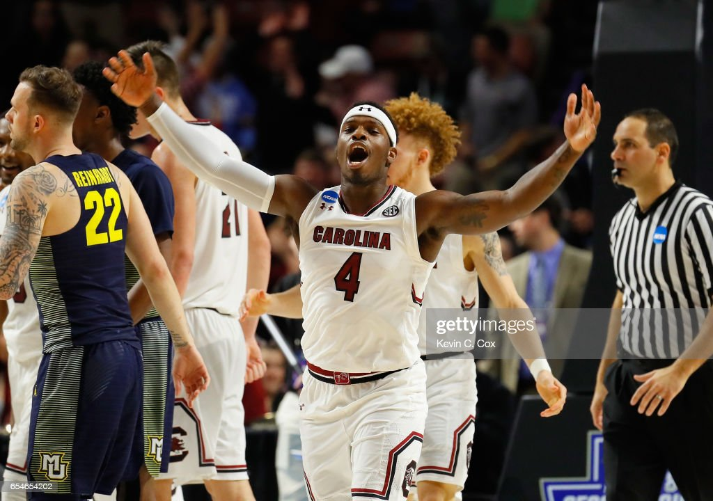 Rakym Felder #4 of the South Carolina Gamecocks celebrates their 93-73 win over the Marquette Golden Eagles during the first round of the 2017 NCAA Men's Basketball Tournament at Bon Secours Wellness Arena on March 17, 2017 in Greenville, South Carolina.