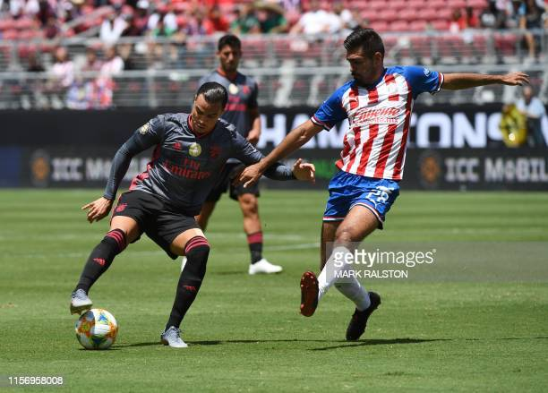 Raúl de Tomás of Benfica clashes with Juan Basulto of Chivas de Guadalajara during their 2019 International Champions Cup match at the Levi's Stadium...