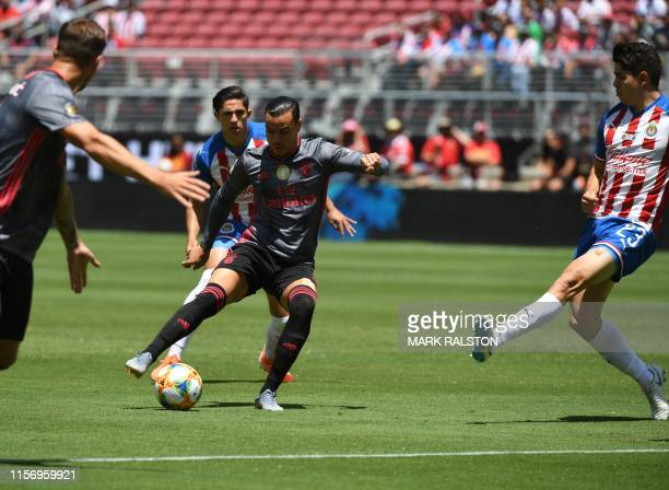 Raúl de Tomás of Benfica takes a shot for goal against Chivas de Guadalajara during their 2019 International Champions Cup match at the Levi's...