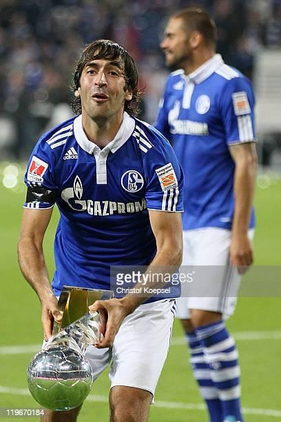 Raúl Gonzalez of Schalke lifts the Supercup trophy after winning the Supercup match between FC Schalke 04 and Borussia Dortmund at Veltins Arena on...