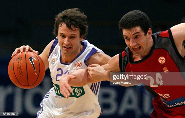 Ral Lopez of Real Madrid and Mark Dickel of Brose Baskets in action during the Euroleague Basketball Game 10 between Real Madrid and Brose Baskets at...