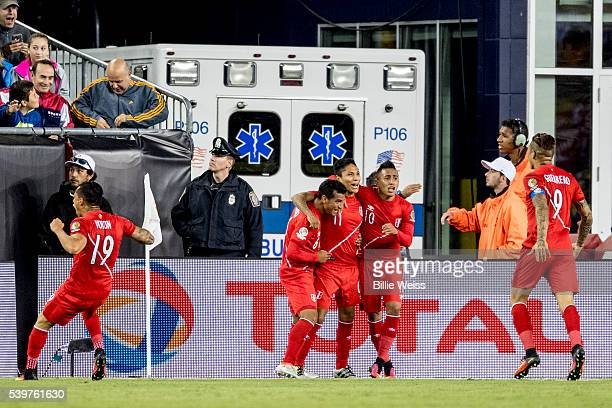 Raúl Ruidíaz of Peru celebrates with teammates after scoring the opening goal during a group B match between Brazil and Peru at Gillette Stadium as...