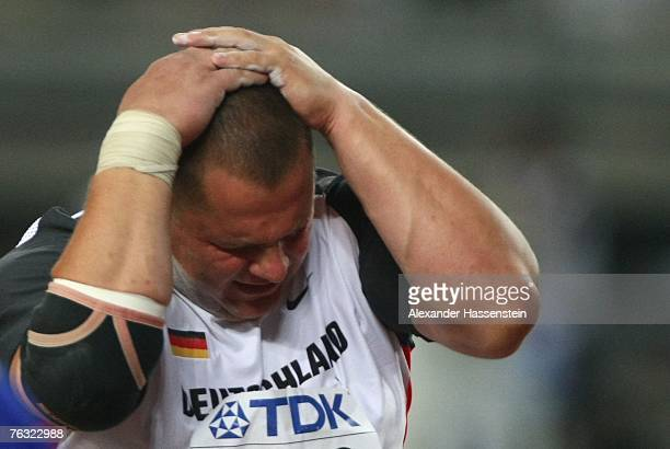 Ralf Bartels of Germany shows his disappointment after competing during the Men's Shot Put on day one of the 11th IAAF World Athletics Championships...