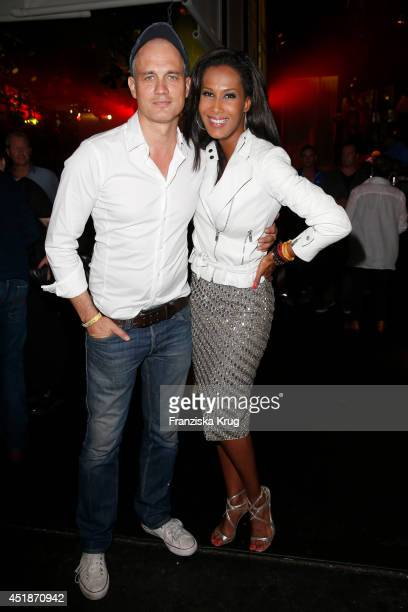 Ralf Bauer and Marie Amiere attend the Arqueonautas Presents Kevin Costner Music Meets Fashion at Spindler Klatt on July 08 2014 in Berlin Germany