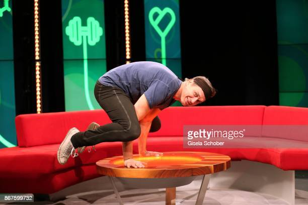 Ralf Bauer doing a yoga exercise during the photo call of 'Gesundheit Die Show' on October 28 2017 at Arri Studio in Munich Germany