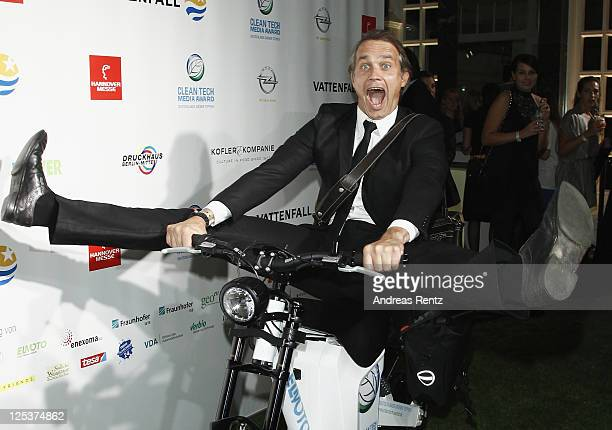Ralf Bauer poses ona electro bike at the Clean Tech Media Award 2011 at Curio house on September 16 2011 in Hamburg Germany