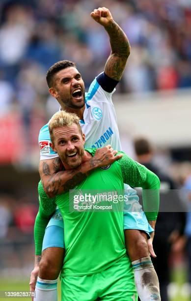 Ralf Faehrmann and Victor Palsson of Schalke celebrate after winning 1-0 the Second Bundesliga match between SC Paderborn 07 and FC Schalke 04 at...