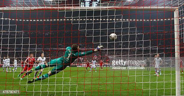 Ralf Faehrmann, keeper of Schalke receives the first goal by David Alaba of Muenchen during the Bundesliga match between FC Bayern Muenchen and FC...