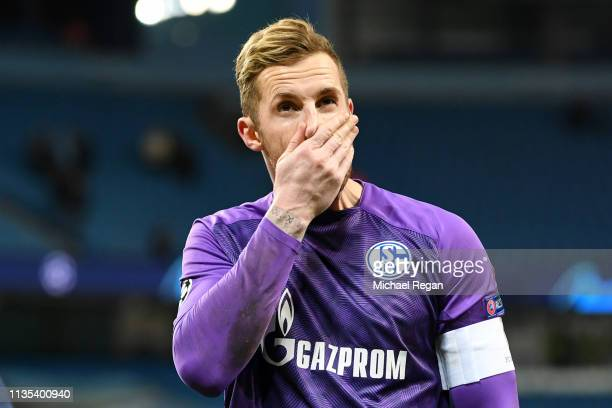 Ralf Faehrmann of FC Schalke 04 reacts after the fans shout towards the players after the UEFA Champions League Round of 16 Second Leg match between...
