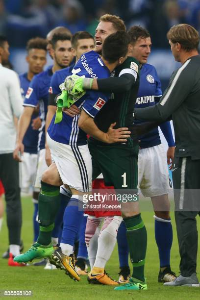 Ralf Faehrmann of Schalke celebrates with Yevhen Konoplyanka of Schalke following their victory during the Bundesliga match between FC Schalke 04 and...