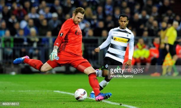 Ralf Faehrmann of Schalke in action against Raffael of Monchengladbach during the UEFA Europa League Round of 16 first leg football match between FC...