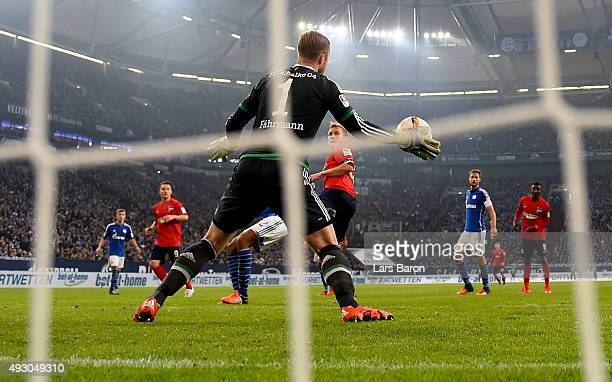 Ralf Faehrmann of Schalke saves a header of Fabian Lustenberg of Berlin during the Bundesliga match between FC Schalke 04 and Hertha BSC Berlin at...