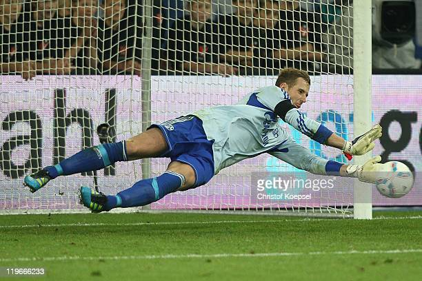 Ralf faehrmann of Schaloke saves the decision penalty of Ivan Perisic of Dortmund and the Supercup match between FC Schalke 04 and Borussia Dortmund...
