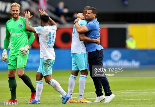 Ralf Faehrmann, Rodrigo Zalazar, Malick Thiaw and head coach Dimitrios Grammozis of Schalke celebrate after winning 1-0 the Second Bundesliga match...