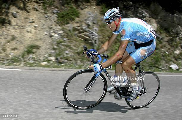 Ralf Grabsch of Germany and Milram in action after he was involved in a crash during Stage 15 of the 93rd Tour de France between Gap and L'Alpe...