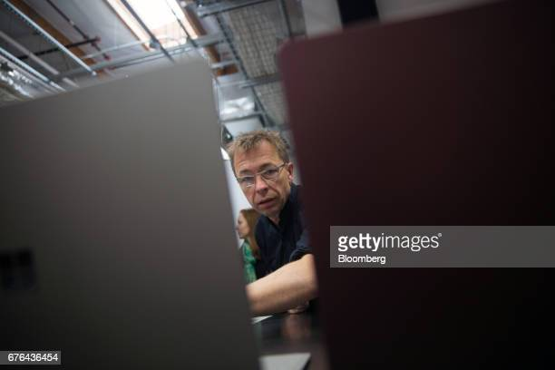 Ralf Groene, head of industrial design for Microsoft Devices, speaks as Surface Laptop computers are displayed at the hardware lab of the Microsoft...