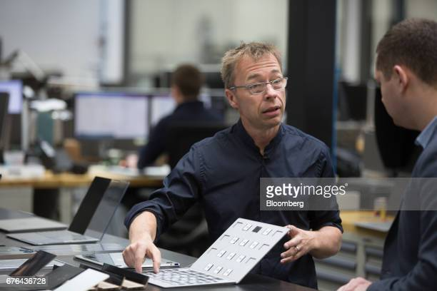 Ralf Groene, head of industrial design for Microsoft Devices, speaks as prototype pieces for Surface Laptop computers are displayed at the hardware...