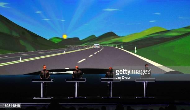 Ralf Hutter Henning Schmitz Fritz Hilpert and Falk Grieffenhagen of German electronic pioneers Kraftwerk perform live on stage during the first night...