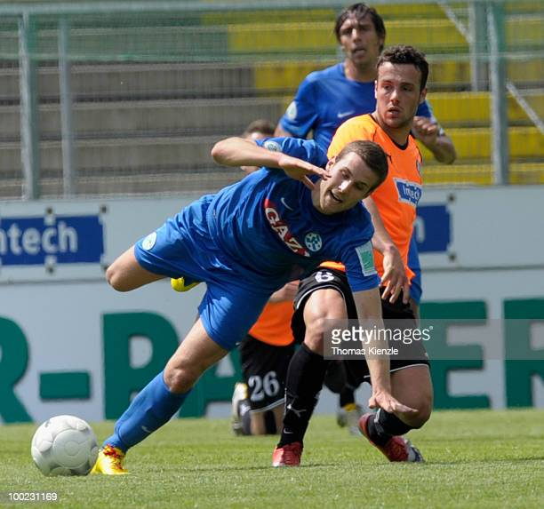 Ralf Kettemann of VfR Aalen tackles MicheleClaudio Rizzi of Stuttgarter Kickers during the Regionalliga match between VfR Aalen and Stuttgarter...