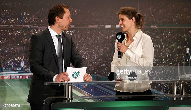 Ralf Koettker, media director of the German Football Association speaks with Britta Heidemann, athlete and Olympic champion in fencing during the DFB...