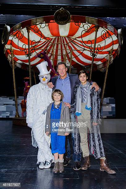 Ralf Moeller and actors Alessandro Strogulski Lino Riester and Merlin Stuebler pose during a photo call during the rehearsals for Keinschneechaos at...