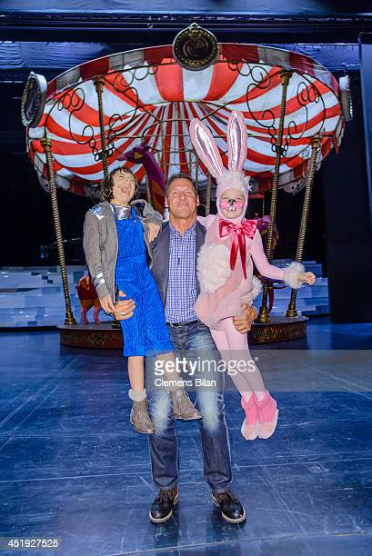 Ralf Moeller and actors Lino Riester and Tamara Silbermann pose during a photo call during the rehearsals for Keinschneechaos at FriedrichstadtPalast...