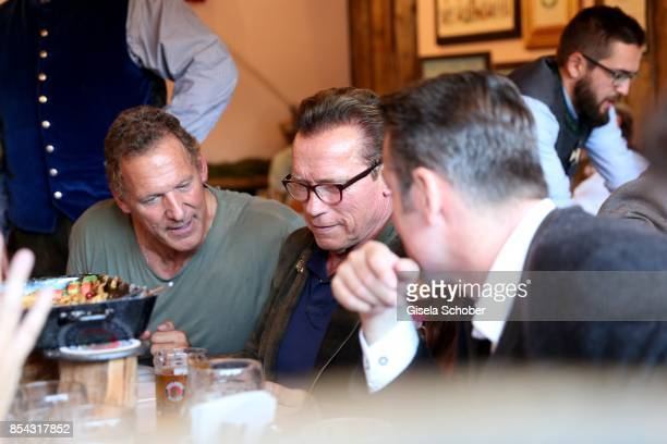 Ralf Moeller and Arnold Schwarzenegger with glasses attends the Oktoberfest at Kaefer Wies'n Schaenke at Theresienwiese on September 26 2017 in...