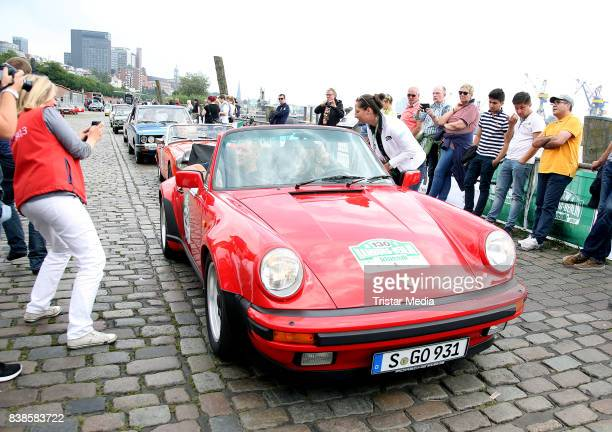 Ralf Moeller and Eve Scheer during the first day of the HamburgBerlin Klassik Rallye on August 24 2017 in Hamburg Germany
