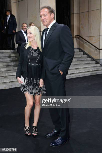 Ralf Moeller and his girlfriend Justine Neubert arrive for the GQ Men of the year Award 2017 at Komische Oper on November 9 2017 in Berlin Germany