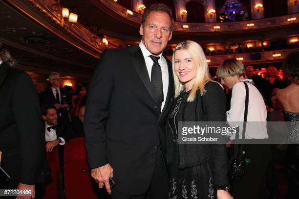 Ralf Moeller and Justine Neubert arrive for the GQ Men of the year Award 2017 at Komische Oper on November 9 2017 in Berlin Germany