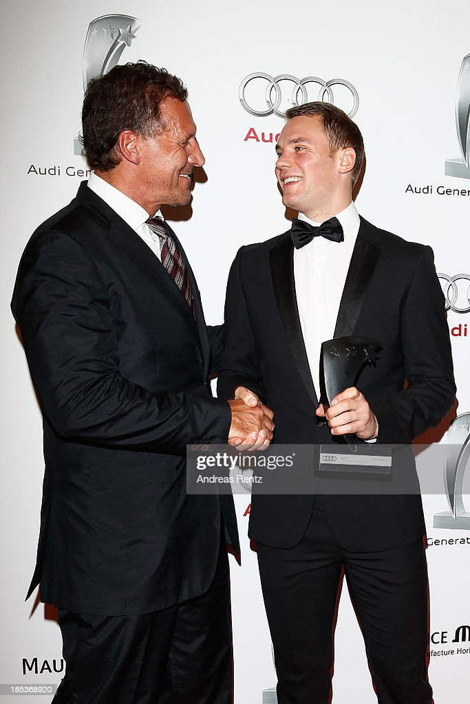Ralf Moeller and Manuel Neuer with his award attend the 7th Audi Generation Award 2013 at Hotel Bayerischer Hof on October 19, 2013 in Munich, Germany.