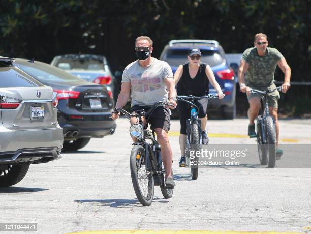 Ralf Moeller Heather Milligan and Arnold Schwarzenegger are seen on April 26 2020 in Los Angeles California