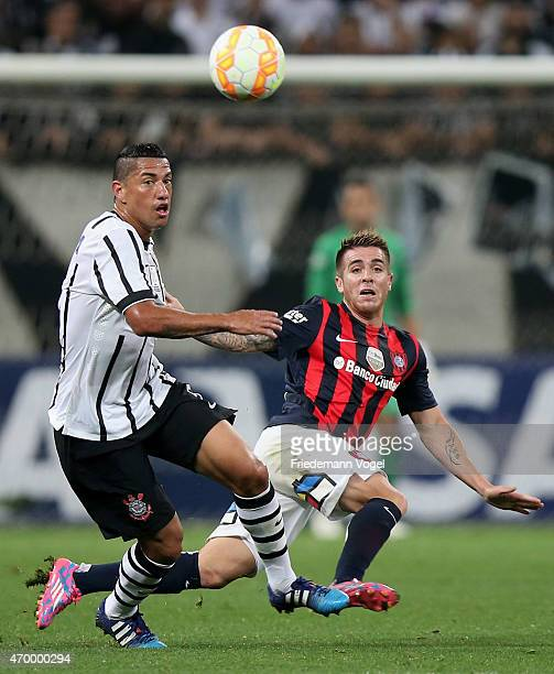 Ralf of Corinthians fights for the ball with Julio Buffarini of San Lorenzo during a match between Corinthians and San Lorenzo as part of Group 2 of...
