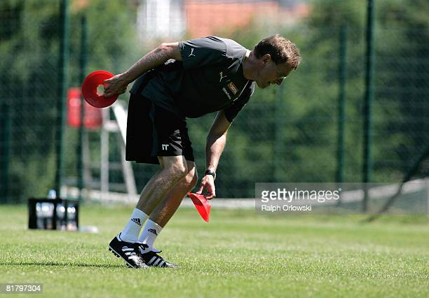 Ralf Rangnick, head coach of TSG 1899 Hoffenheim puts down a mark during a training session at their training camp on July 2, 2008 in Stahlhofen near...