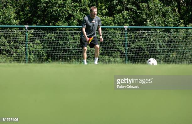 Ralf Rangnick head coach of TSG 1899 Hoffenheim puts down a mark during a training session at their training camp on July 2 2008 in Stahlhofen near...