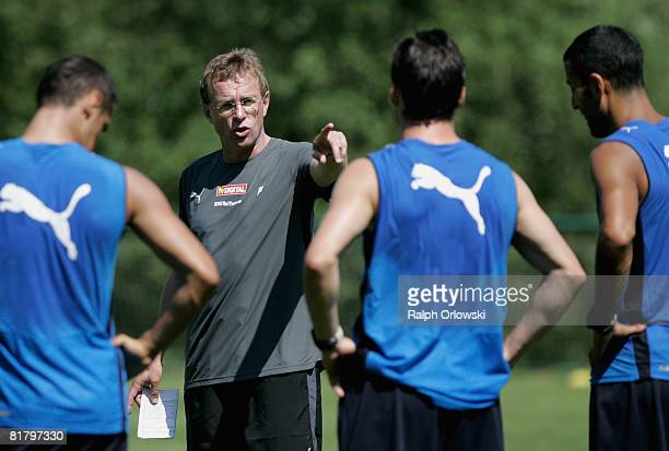 Ralf Rangnick head coach of TSG 1899 Hoffenheim speaks to his players during a training session at their training camp on July 2 2008 in Stahlhofen...