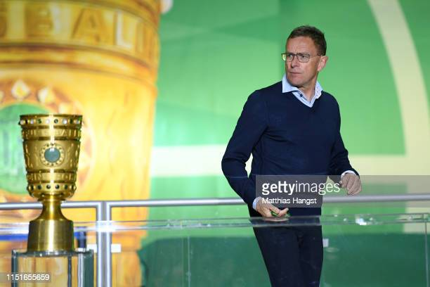 Ralf Rangnick, Manager of RB Leipzig walks past the trophy in defeat after the DFB Cup final between RB Leipzig and Bayern Muenchen at Olympiastadion...