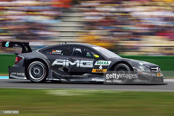 Ralf Schumacher of Germany and Mercedes AMG steers his car during the first race of the DTM German Touring Car Championship at Hockenheimring on...