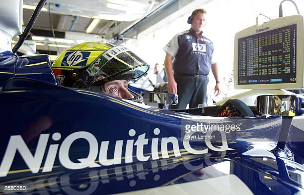 Ralf Schumacher of Germany and Williams keeps an eye on his lap times during the first practice for the Formula One Japanese Grand Prix in Suzuka on...
