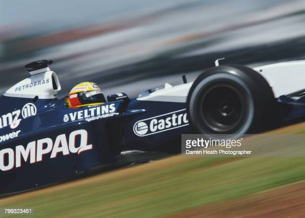 Ralf Schumacher of Germany drives the BMW Williams F1 Team Williams FW24 BMW V10 during the Formula One Brazilian Grand Prix on 31 March 2002 at the...