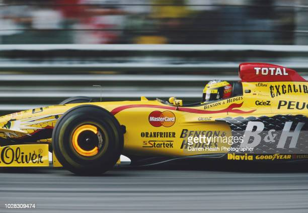 Ralf Schumacher of Germany lights up the brake discs as he drives the Benson & Hedges Total Jordan Peugeot Jordan197 Peugeot V10 during the Formula...