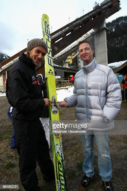Ralf Schumacher talks to Sven Hannawald during the FIS Ski Jumping World Cup event at the 58th Four Hills ski jumping tournament at Erdinger Arena on...