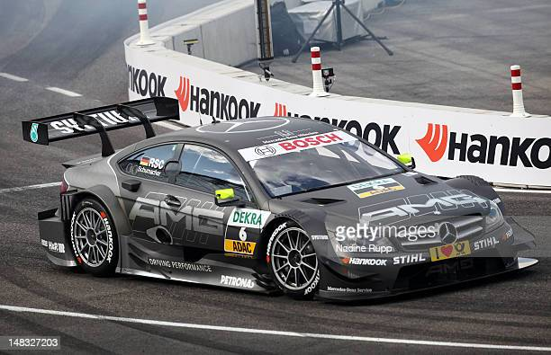 Ralf Schumacher wins the final race with his team mate during the DTM German Touring Car - Munich 2012 at Olympiastadion on July 14, 2012 in Munich,...