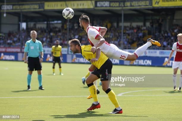 Ralf Seuntjens of VVVVenlo Mitchell Dijks of Ajax during the Dutch Eredivisie match between VVV Venlo and Ajax Amsterdam at Seacon stadium De Koel on...