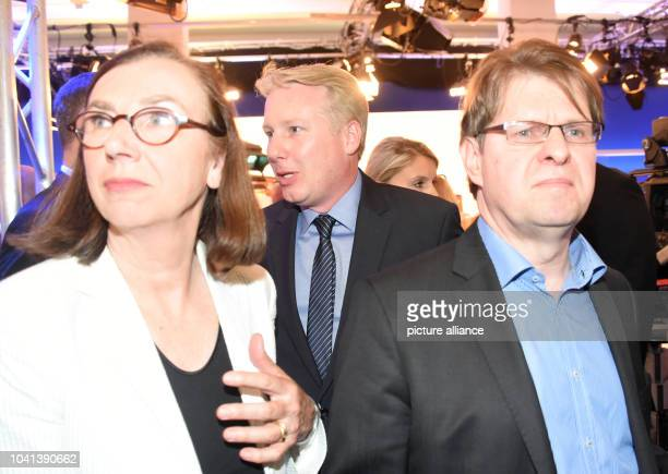 Ralf Stegner SPD state leader in the election studio while AfD prime candidate Joerg Nobis is pictured in the background in Kiel Germany 7 May 2017...