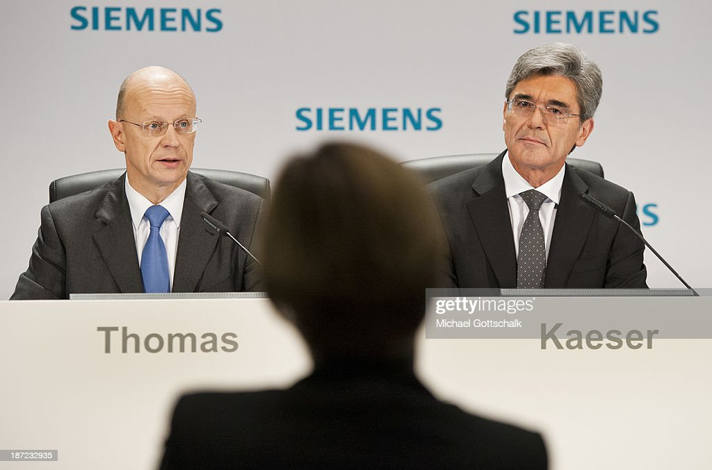 Ralf Thomas and CEO of German engineering giant Siemens AG, Joe Kaeser (R) attend Siemens annual press conference on November 7, 2013 in Berlin, Germany. German engineering giant Siemens said Thursday it expects to book a further increase in bottom-line earnings in 2014 after achieving its targets this year.